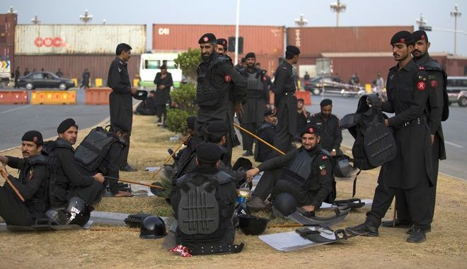 Pakistani government security personnel standby near the Parliament during a sit-in protest by the religious radical party, Tehreek-i-Labaik Ya Rasool Allah, in Islamabad, Pakistan, Friday, Nov. 10, 2017. Hundreds of Islamists have camped out on the edge of Pakistan's capital to demand the removal of the country's law minister over a recently omitted reference to the Prophet Muhammad in a constitutional bill. (AP Photo/B.K. Bangash)