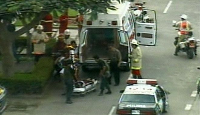 An unidentified victim is loaded into an ambulance near the Japanese ambassador's residence in Lima, Peru, in this image made from television Tuesday April 22, 1997, after Peruvian government troops stormed the compound where Tupac Amaru terroprists have held hostages since they seized the compound on Dec. 17, 1996.(AP Photo )