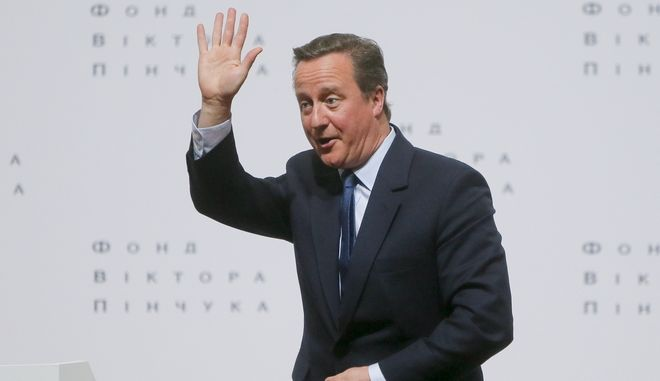 "Britain's former Prime Minister David Cameron gestures as leaves a public lecture ""Ukraine's Place in a changing world"" at the Institute of International Relations of the National University in Kiev, Ukraine, Wednesday, March 29, 2017. (AP Photo/Efrem Lukatsky)"