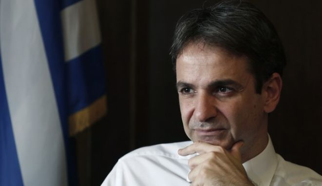 """Greek Administrative Reform Minister Kyriakos Mitsotakis listens during an interview with the Associated Press in Athens, on Tuesday, April 8, 2014. Mitsotakis said years of austerity have left Greece with about 200,000 fewer civil servants than before its debt crisis erupted in late 2009. He added that  the country has made significant overall progress, which should allow it to tap international capital markets """"in the foreseeable future."""" (AP Photo/ Petros Giannakouris)"""