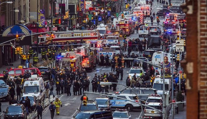 Law enforcement officials work following an explosion near New York's Times Square on Monday, Dec. 11, 2017. Police said a man with a pipe bomb strapped to him set off the crude device in an underground passageway under 42nd Street between Seventh and Eighth Avenues. (AP Photo/Andres Kudacki)