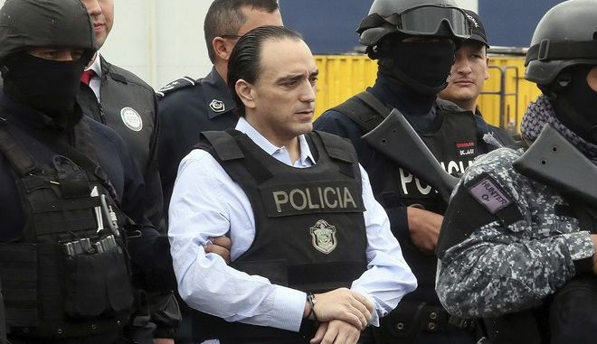 In this photo released by the Panama Foreign Ministry, Mexico's former Quintana Roo state Gov. Roberto Borge is escorted to a waiting plane in Panama City, Thursday, Jan. 4, 2018. Panama extradited the fugitive Mexican ex-governor wanted on corruption charges after holding him in custody for more than six months. (Efren Giron/Panama Foreign Ministry via AP)