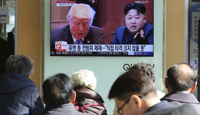"FILE- In this Tuesday, Nov. 21, 2017, file photo, people watch a TV screen showing images of U.S. President Donald Trump, left, and North Korean leader Kim Jong Un at Seoul Railway Station in Seoul, South Korea. North Korea has called U.S. President Donald Trump's decision to relist the country as a state sponsor of terrorism a ""serious provocation"" that justifies its development of nuclear weapons. (AP Photo/Ahn Young-joon, File)"