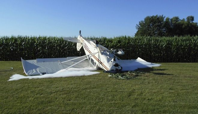 In this July 18, 2017 photo released by the Midland County Sheriff's Department, a 1959 Piper Pacer single engine plane is shown upside down in Jasper Township, Mich. Ronald Lee Schultz, 79, escaped serious injury after crashing while attempting to land at a grass landing strip. (Midland County Sheriffs Department via AP)