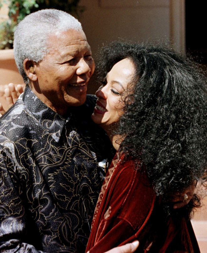 South African President Nelson Mandela and pop singer Diana Ross embrace outside of Mandelas residence in Johannesburg April 8. Diana Ross is in South Africa to perform one concert at the official opening of the brand new leading venue in Gauteng, the MTN Sundome.  SAFRICA ROSS - RTRD0SN