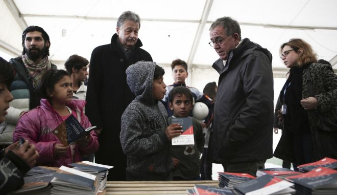 Distribution of lexicons of Farsi and Urdu and Greek by Minister for Immigration Policy Giannis Mouxalas and Swiss Ambassador in Greece Hans-Rudolf Hodel, at the refugees in Elaionas Camp, in Athens, on Jan. 30, 2017 /                 ,   ,    ,  30 , 2017