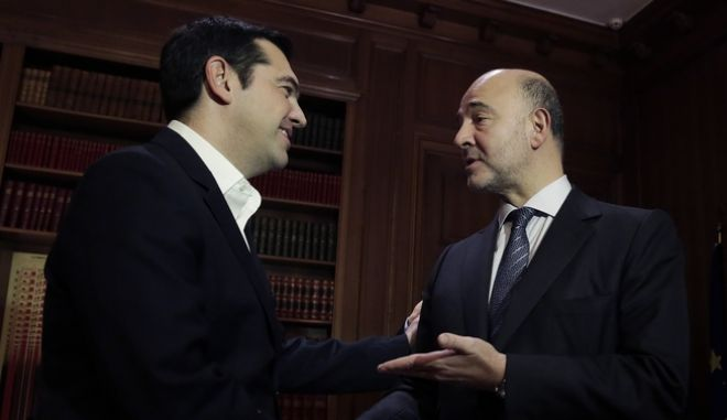 Greek Prime Minister Alexis Tsipras, left, meets with European Commissioner for Economic and Financial Affairs Pierre Moscovici in Athens, on Tuesday, Nov. 3, 2015. Moscovici's talks with officials in Greece's leftwing government will focus on  the progress of reforms demanded by the country's European creditors in return for a third multi-billion euro bailout. (AP Photo/Petros Giannakouris)