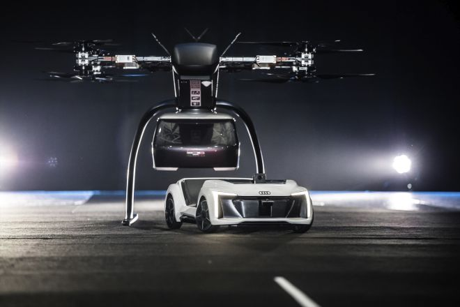 At Drone Week in Amsterdam Audi, Airbus and Italdesign are presenting for the first time a flying and driving prototype of Pop.Up Next. This innovative concept for a flying taxi combines a self-driving electric car with a passenger drone. In the first public test flight, the flight module accurately placed a passenger capsule on the ground module, which then drove from the test grounds autonomously. This is still a 1:4 scale model.