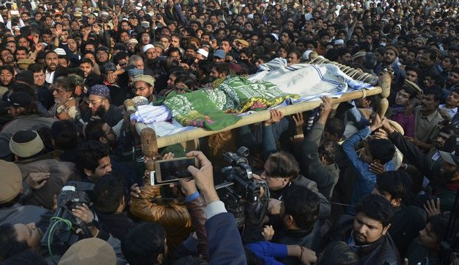 People attend a funeral of a Pakistani girl who was raped and killed, in Kasur, Pakistan, Wednesday, Jan. 10, 2018. Pakistani police said a mob angered over the recent rape and murder of an 8-year-old girl has attacked a police station in eastern Punjab province, triggering clashes that left at least two people dead and several injured. (AP Photo/Qazi Mehmood)