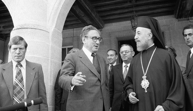 Secretary of State Henry A. Kissinger gesture as he talks with Archbishop Makarios, President of Cyprus, prior to meeting with Soviet Foreign Minister Andrei Gromyko in Nicosia on Tuesday, May 7, 1974. Second from left is Joseph Sisco, assistant Secretary of State. Other man is unidentified. (AP Photo)