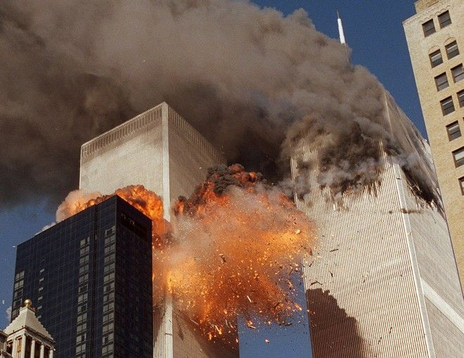 FILE - In this Sept. 11, 2001, file photo, smoke billows from one of the towers of the World Trade Center and flames as debris explodes from the second tower in New York. A bill passed by Congress allowing the families of 9/11 victims to sue the Saudi government has reinforced to some in the Arab world a long-held view that the U.S. only demands justice for its own victims of terrorism, despite decades of controversial U.S. interventions around the world.(AP Photo/Chao Soi Cheong, File)