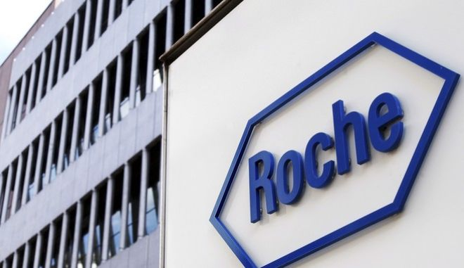 ** FILE ** The logo of Swiss pharmaceutical company Roche is seen in Basel, Switzerland, in this Aug. 12, 2005 file photo. Pharmaceuticals giant Roche Holding AG said Wednesday, Jan. 30, 2008 strong sales of its anti-cancer drugs helped lift full-year net profit by 25 percent to 11.44 billion Swiss francs (US$10.48 billion; euro7.09 billion). Sales reached 46.1 billion francs (US$42.22 billion; euro28.58 billion), beating those of its rival Novartis, which posted sales last year of 43.5 billion francs (US$39.83 billion; euro26.97 billion). (AP Photo/Keystone, Steffen Schmidt, File)