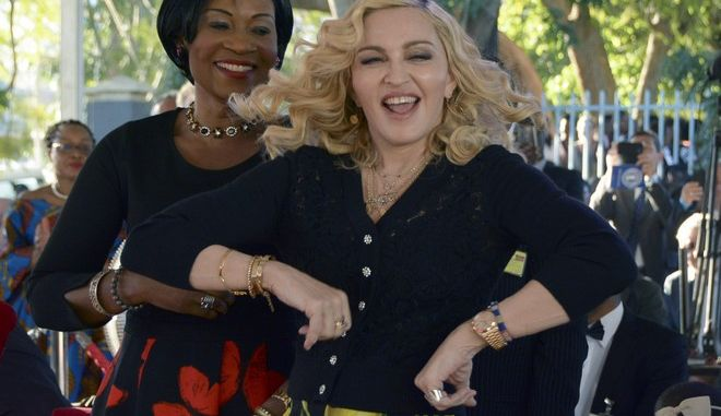 US musician Madonna dances at the opening of The Mercy James Institute for Pediatric Surgery and Intensive Care, located at the Queen Elizabeth Central Hospital in the city of Blantyre, Malawi, Tuesday, July 11, 2017. Madonna was in Malawi on Tuesday for the official opening of a hospital children's wing funded by her charity and named after one of the four children the pop star has adopted from the impoverished southern African nation. (AP Photo Thoko Chikondi)
