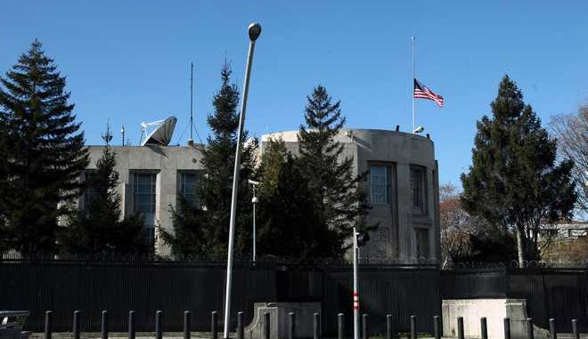 The U.S. flag at the embassy flies at half-staff a day after a suicide bomber attack, in Ankara, Turkey, Saturday, Feb. 2, 2013. The suicide bomber who struck the U.S. Embassy in Ankara spent five years in prison on terrorism charges but was released after being diagnosed with a hunger strike-related brain disorder, officials said Saturday. The bomber, identified as 40-year-old leftist militant Ecevit Sanli, killed himself and a Turkish security guard on Friday, in what U.S. officials said was a terrorist attack.  (AP Photo/Burhan Ozbilici)