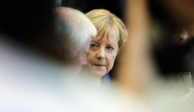 Angela Merkel, right, German Chancellor and Christian Democratic Union, CDU, chairwoman listens to Bavarian state governor and Christian Social Union, CSU, party chairman Horst Seehofer, left, as they attend  the parliamentary caucus of Merkel's conservative Union bloc in Berlin, Germany, Tuesday, Sept. 26, 2017.(AP Photo/Markus Schreiber)