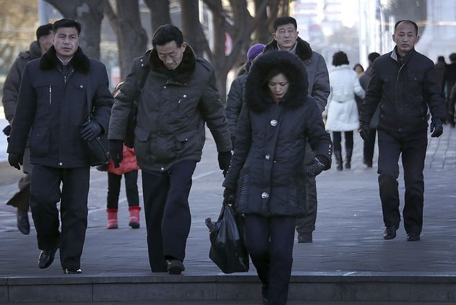 North Koreans walk into an underpass at the end of the day on Sunday, Feb. 12, 2017, in Pyongyang, North Korea. (AP Photo/Wong Maye-E)