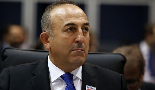 Turkish Foreign Minister Mevlut Cavusoglu attends at the opening session of the 22st OSCE Ministerial Council, in Belgrade, Serbia, Thursday, Dec. 3, 2015. Turkey's Foreign Ministry says the Turkish and Russian foreign ministers will meet on the sidelines of an Organization for Security and Cooperation meeting in the Serbian capital Belgrade. (AP Photo/Darko Vojinovic)