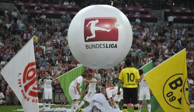 A balloon with the logo of the German first soccer league is seen inside the stadium, prior to the German first division Bundesliga soccer match between FC Bayern Munich and Vfl Wolfsburg in Munich, southern Germany, Friday, Aug. 20, 2010. (apn Photo/Uwe Lein) ** Eds note: German spelling of Munich is Muenchen ** NO MOBILE USE UNTIL 2 HOURS AFTER THE MATCH, WEBSITE USERS ARE OBLIGED TO COMPLY WITH DFL-RESTRICTIONS, SEE INSTRUCTIONS FOR DETAILS **