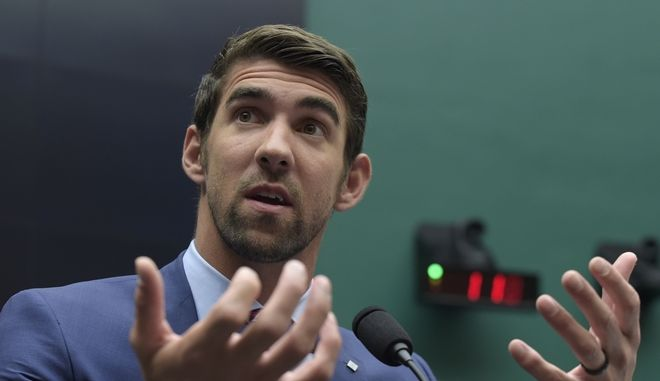 Olympic swimmer Michael Phelps testifies on Capitol Hill in Washington, Tuesday, Feb. 28, 2017, before the House Commerce Energy and Commerce subcommittee hearing on the international anti-doping system. (AP Photo/Susan Walsh)