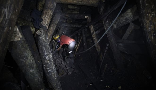 Pedro Alarcon operates a drill inside the tunnel of La Flauta coal mine in Tausa, Colombia, Tuesday, Sept. 24, 2013. Tausa residents fear that La Flauta will be closed if authorities declare the area a nature reserve in which mining is prohibited. However, government officials say authorities do not plan to close Tausas mines. (AP Photo/Fernando Vergara)