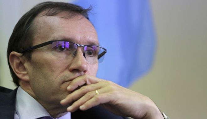 """U.N envoy Espen Barth Eide talks during an interview for the Associated Press at his office inside the U.N buffer zone at the abandoned Nicosia airport in the divided capital Nicosia, Cyprus, Thursday, April 13, 2017. A United Nations envoy says an """"idea"""" has emerged that may help overcome the key obstacle of security which stands in the way of a deal reunifying ethnically divided Cyprus.  (AP Photo/Petros Karadjias)"""