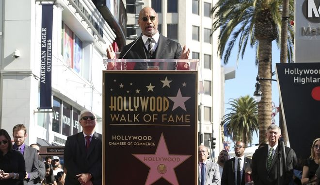 Dwayne Johnson speaks at his star ceremony at the Hollywood Walk of Fame on Wednesday, Dec. 13, 2017, in Los Angeles. (Photo by Willy Sanjuan/Invision/AP)