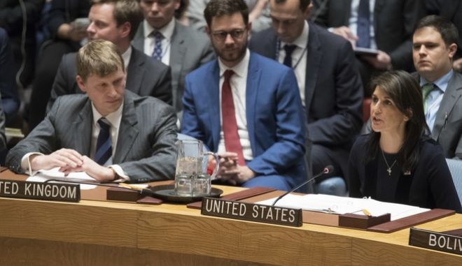 British Deputy Ambassador to the United Nations Jonathan Allen, right, listens as American Ambassador to the United Nations Nikki Haley speaks during a Security Council meeting on the situation between Britain and Russia, Wednesday, March 14, 2018 at United Nations headquarters. Britain said Wednesday it would expel 23 Russian diplomats and sever high-level bilateral contacts after Russia ignored a deadline to explain how a Soviet-developed nerve agent was used against ex-spy Sergei Skripal and his daughter Yulia. (AP Photo/Mary Altaffer)