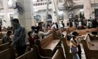 People look at damage inside the St. George's after a suicide bombing, in the Nile Delta town of Tanta, Egypt, Sunday, April 9, 2017. Bombs exploded at two Coptic churches in the northern Egyptian cities of Tanta and Alexandria as worshippers were celebrating Palm Sunday, killing over 40 people and wounding scores more in assaults claimed by the Islamic State group. (AP Photo/Nariman El-Mofty)