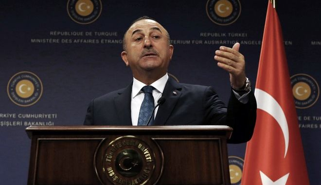 "Turkey's Foreign Minister Mevlut Cavusoglu speaks during a joint news conference after talks with Greek Foreign Minister Nikos Kotzias in Ankara, Turkey, Tuesday, Oct. 24, 2017. Cavusoglu said Tuesday neighboring Greece should not become a ""haven"" for people suspected of links to last year's failed coup to flee to and evade prosecution in Turkey. (AP Photo/Burhan Ozbilici)"