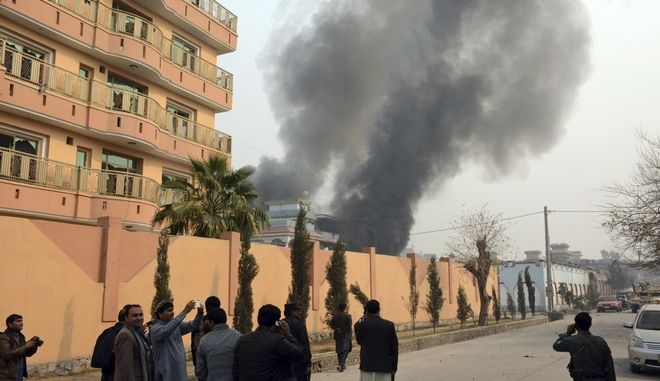 Smokes rises after a deadly suicide attack in Jalalabad, east of Kabul, Afghanistan, Wednesday, Jan. 24, 2018. Attahullah Khogyani, spokesman for the provincial governor, said a group of gunmen stormed the office of the non-governmental organization, Save the Children. (AP Photo)