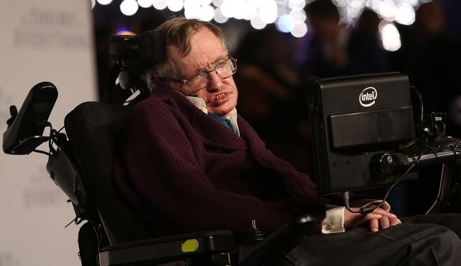 Professor Stephen Hawking arrives on the blue carpet for the UK premiere of The Theory Of Everything at the Odeon in Leicester Square, central London, Tuesday, Dec. 9, 2014. (Photo by Joel Ryan/Invision/AP)