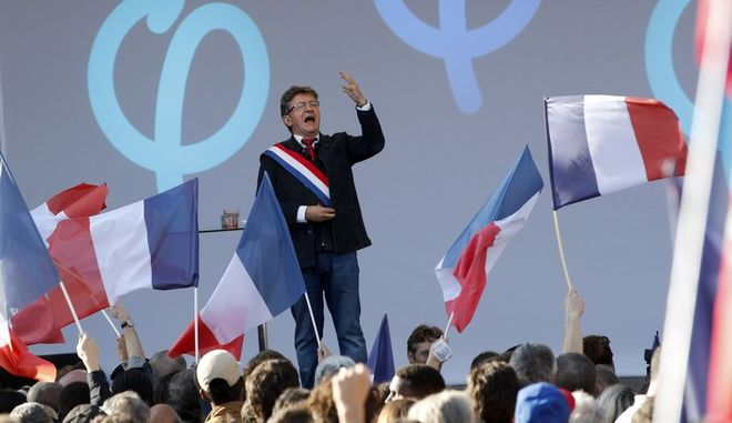 French far-left leader Jean-Luc Melenchon speaks to his supporters during a protest over the president's labor reform in Paris, France, Saturday, Sept. 23, 2017. Melenchon rallied disaffected voters Saturday against President Emmanuel Macron's plan to weaken worker protections, amid spreading discontent with Macron's vision of a more business-friendly economy.(AP Photo/Christophe Ena)