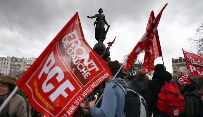 Supporters of French Front de Gauche candidate for the 2012 French presidential election Jean-Luc Melenchon take part in a march from Nation to Bastille, on March 18, 2012 in Paris. Thousands of people are expected to support the firebrand leftist presidential candidate Melenchon, who has shaken up France's election campaign with a surprise jump in the polls. Melenchon, represents a coalition of leftist parties including the Communists. AFP PHOTO /THOMAS COEX