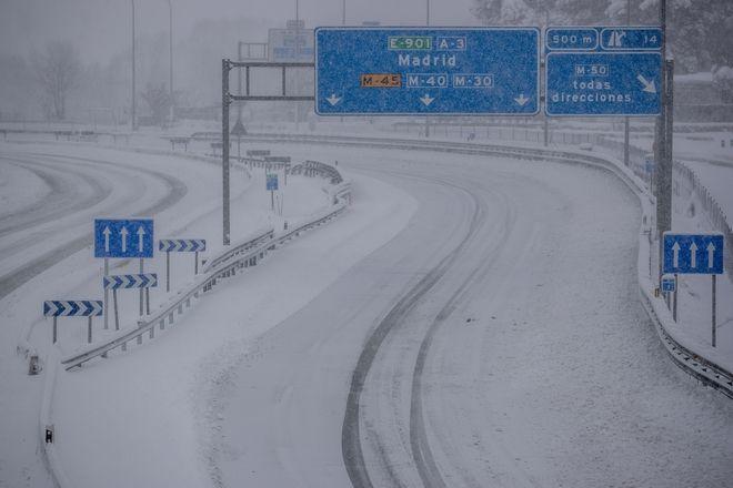 A view from a highway covered with snow during a heavy snowfall in Rivas Vaciamadrid, Spain, Saturday, Jan. 9, 2021. An unusual and persistent blizzard has blanketed large parts of Spain with snow, freezing traffic and leaving thousands trapped in cars or in train stations and airports that had suspended all services as the snow kept falling on Saturday. The capital, Madrid, and other parts of central Spain activated for the first time its red weather alert, its highest, and called in the military to rescue people from cars vehicles trapped in everything from small roads to the city's major thoroughfares. (AP Photo/Manu Fernandez)