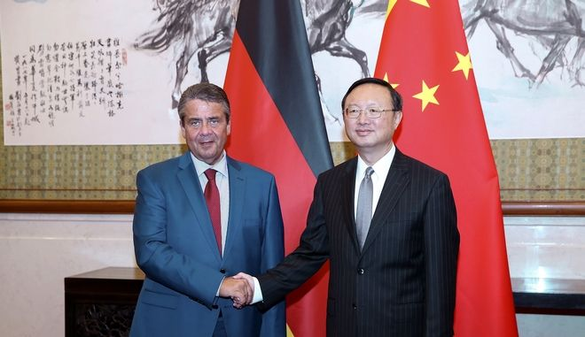 German Foreign Minister Sigmar Gabriel, left, shakes hands with Chinese State Councilor Yang Jiechi before their meeting at Diaoyutai State Guesthouse Sunday, Sept. 17, 2017 in Beijing, China. (Lintao Zhang/Pool Photo via AP)