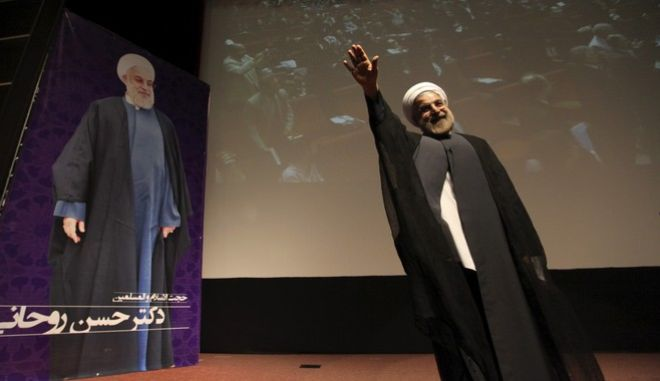 In this Thursday, May 2, 2013 photo, Iran's former nuclear negotiator, Hasan Rohani, a potential front-runner in the presidential race, waves to his supporters in a campaign rally in Tehran, Iran. For eight years, Irans President Mahmoud Ahmadinejad has played the role of global provocateur-in-chief: questioning the Holocaust, saying Israel should be erased from the map and painting U.N resolutions as worthless. Now, a race is beginning to choose his successor -- candidate registration starts Tuesday for a June 14 vote -- and it looks like an anti-Ahmadinejad referendum is shaping up. (AP Photo/Vahid Salemi)