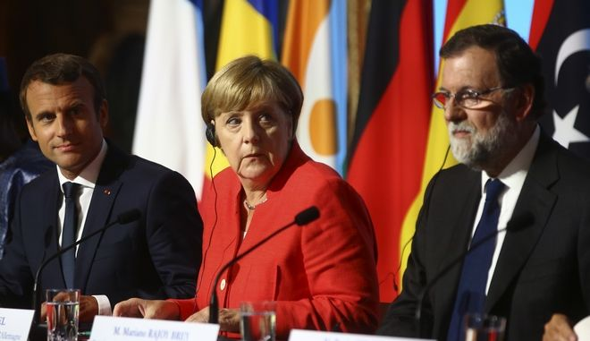 Chad President Idriss Deby, left, French President Emmanuel Macron, second left, German Chancellor Angela Merkel and Spanish Prime Minister Mariano Rajoy attend a joint press conference at the Elysee Palace in Paris, Monday, Aug.28, 2017. The leaders of France, Germany, Italy and Spain are meeting Monday with counterparts from Libya, Niger and Chad to discuss ways to curb illegal migration across the Mediterranean Sea to European shores. (AP Photo/Thibault Camus)