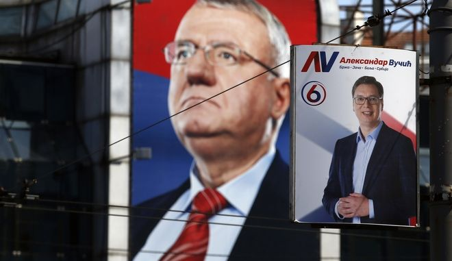Pre-election posters showing current Serbian Prime Minister and presidential candidate Aleksandar Vucic, right, and ultranationalist Serbian Radical Party leader Vojislav Seselj was Vucic's mentor in the 1990s', in Belgrade, Serbia, Thursday, March 30, 2017.   The first round of presidential elections is scheduled for Sunday April 2, 2017, that will test the popularity of dominant populist leader Aleksandar Vucic against an array of vociferous opposition candidates. (AP Photo/Darko Vojinovic)
