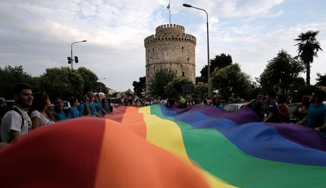 "Gay activists waves a rainbow movement flag in front of the White Tower, during a Pride parade, in Thessaloniki, Saturday, June 21, 2014. Thousands gay activists in Thessaloniki, Greece have organized the 3rd Thessaloniki Pride festival, a 2-day event that included a parade around the citys center. The organization of the event drew heavy criticism from conservative circles and there was a protest march against ""the sodomites"" on Friday. Thessaloniki, Greece on June 21, 2014."