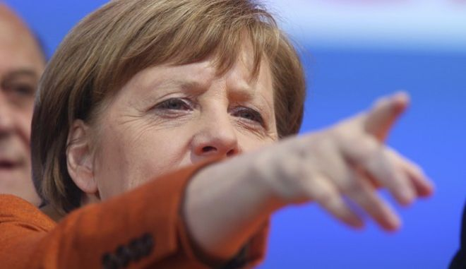 FILE - In this March 23, 2017 file photo German Chancellor Angela Merkel points during an election campaign of the Saarland Christian democrats, CDU, in St.Wendel, Germany. The federal state elections for Saarland state will be on Sunday March 26. (AP Photo/Michael Probst, file)