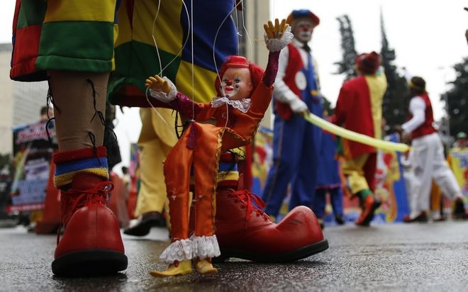 Clowns hold an anti-government protest in Bogota, Colombia, Tuesday, May, 9, 2017. Members of the National Union of Circus Artists from across the country marched in Bogota to protest the government's economic policies, demand better job opportunities and better access to healthcare. (AP Photo/Fernando Vergara)