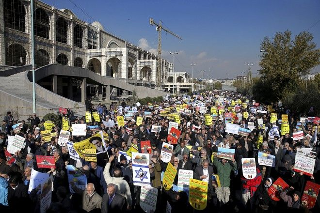 Iranian worshippers chant slogans in a rally after Friday prayer in Tehran, Iran, Friday, Dec. 8, 2017. Hundreds staged a rally to show their anger against the U.S. President Donald Trump administration's recognition this week of Jerusalem as the capital of Israel. (AP Photo/Ebrahim Noroozi)