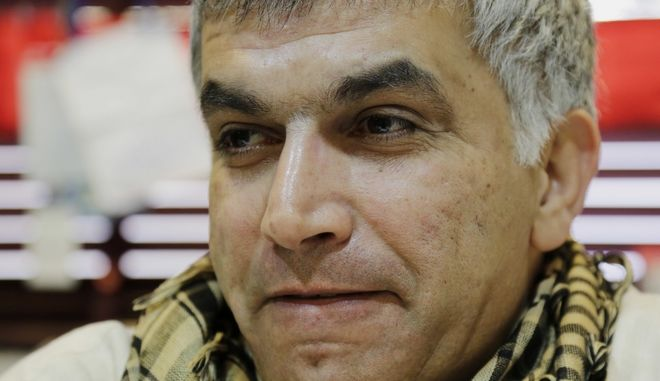 FILE - In this Jan. 20, 2015 file photo, Nabeel Rajab, one of Bahrain's best-known human rights activists, talks to The Associated Press in Bani Jamra, Bahrain. On Tuesday, June, 14, 2016, Bahrain said it has suspended all activities by Al-Wefaq, the largest Shiite opposition political group, and frozen its assets amid a widening crackdown on dissent, five years after the countrys Arab Spring protests. The sudden court case came a day after authorities detained Rajab, a prominent activist and the president of the Bahrain Center for Human Rights. Zainab al-Khawaja, another prominent activist, fled for Denmark in recent days over fears of being imprisoned again. (AP Photo/Hasan Jamali, File)