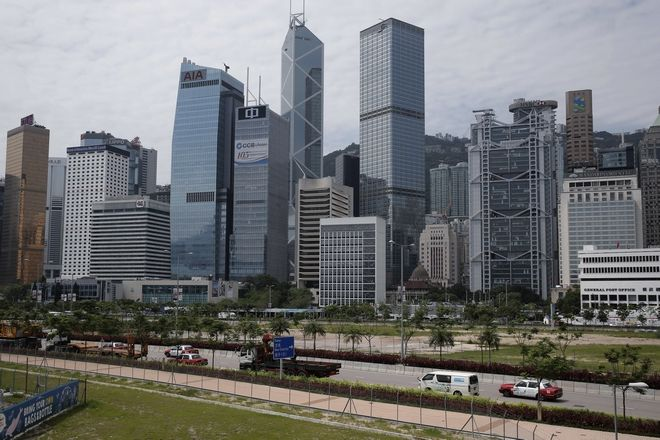 This Thursday, May 25, 2017, photo shows a general view of the Central, a business district of Hong Kong. The Standard & Poor's rating agency has cut its credit rating for Hong Kong a day after downgrading China, citing risks posed by close ties between the two places. S&P said Friday that it was reducing its long-term rating on Hong Kong by one notch, to AA+ from AAA, reflecting potential spillover risks to the Asian financial center. (AP Photo/Kin Cheung)