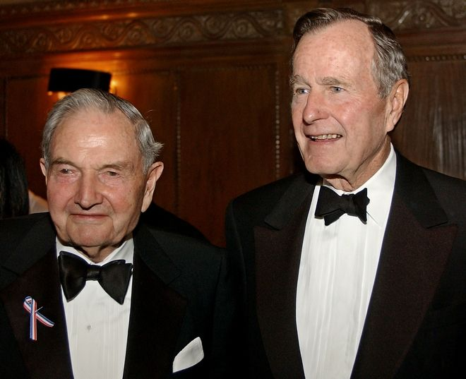 Former President George Bush, right, stands with David Rockefeller, left, at a cocktail reception before he was presented with the Marshall Award by the George C. Marshall Foundation at Cipriani's in New York, Friday, March 8, 2002. The former President was honored for his exceptional leadership in the international community during times of global crisis. (AP Photo/Stephen Chernin)