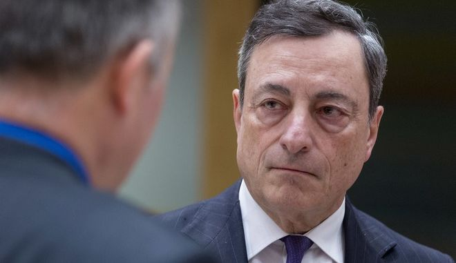 President of the European Central Bank Mario Draghi arrives prior to a round table meeting of Eurogroup finance ministers at the EU Council building in Brussels on Monday, Feb. 20, 2017. The eurozone's 19 finance ministers will be looking to defuse the risk of another Greek crisis as they try to agree Monday on what reforms Greece must still take to qualify for more loans. (AP Photo/Thierry Monasse)