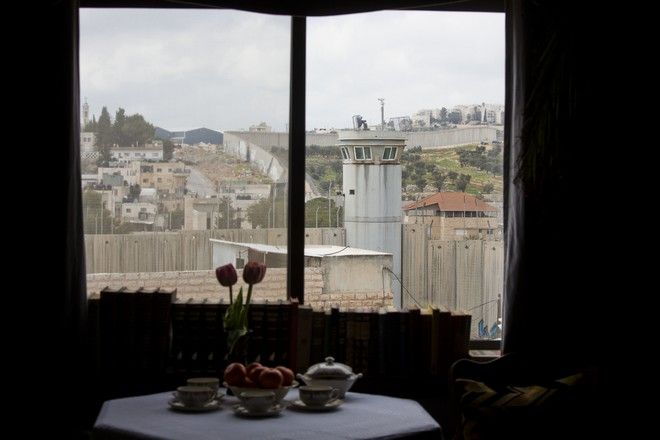 An Israeli security watch tower is seen from one of the rooms of the