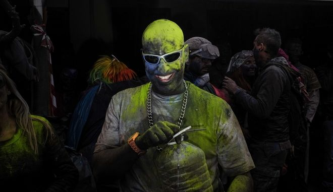 Revellers celebrate Clean Monday by participating in a colourful flour war in the port town of Galaxidi, on Feb. 19, 2018 /      ,  19 , 2018