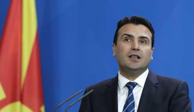 Macedonian Prime Minister Zoran Zaev briefs the media after a meeting with German Chancellor Angela Merkel at the chancellery in Berlin, Wednesday, Feb. 21, 2018. (AP Photo/Markus Schreiber)
