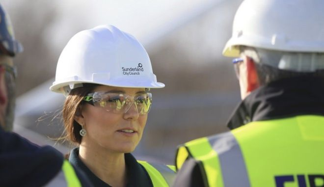 Kate  Duchess of Cambridge talks to construction workers during a visit to the Northern Spire bridge across the River Wear in Sunderland northeast England, Wednesday Feb. 21, 2018.  (Danny Lawson/PA via AP)